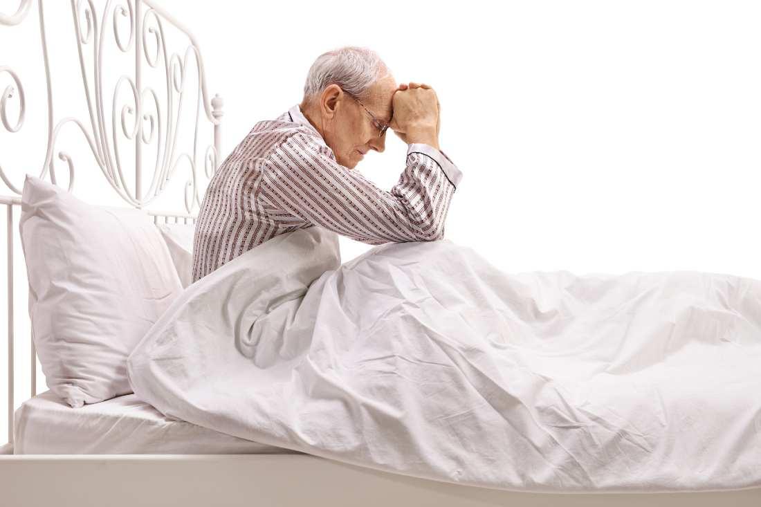 Depressed Senior Stressed In Bed