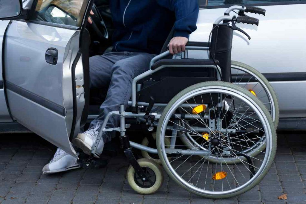 Disabled Man Getting Into Car