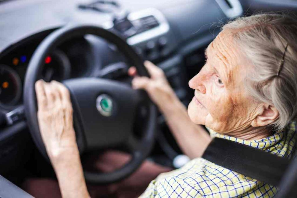 Elderly Person At The Wheel Of Car