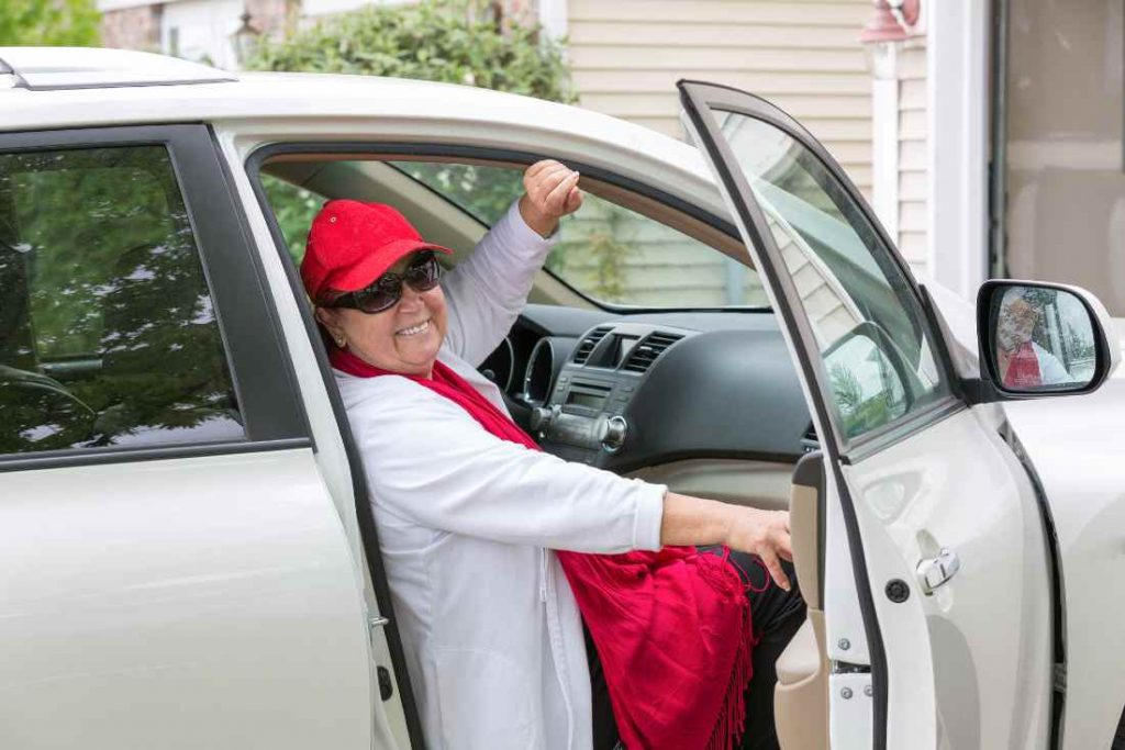 Senior Getting Out Of Car